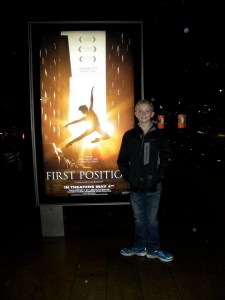 Aran Bell with the movie poster for First Position