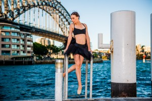 Simonne Smiles posing against the backdrop of the Sydney Harbour Bridge, photo © Denis Alexandrov