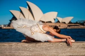 Simonne Smiles, the swan and the sails of the Sydney Opera House, photo © Denis Alexandrov